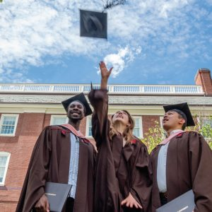 Graduate tosses cap in the air
