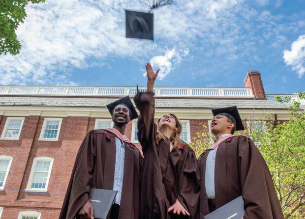 Graduate tosses cap in the air