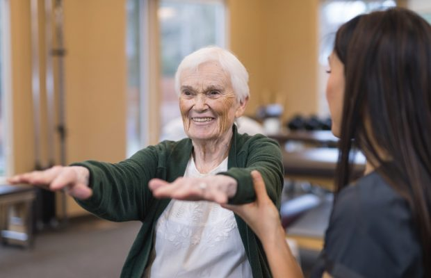 Older woman holds hands directly in front of her